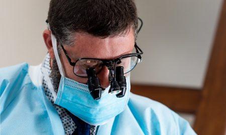 Dr. Tetri examining patient