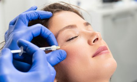 Woman getting injection in face
