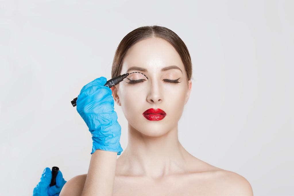 Woman getting eyelid surgery