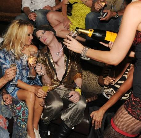 Pamela Anderson and Richie Rich from Heatherette at Tao Nightclub.