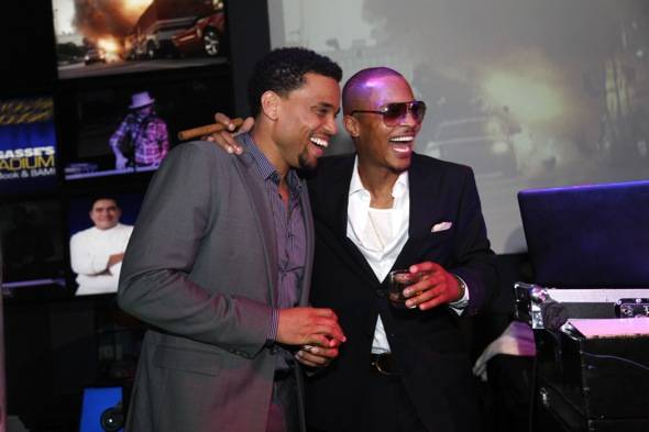 TI and Michael Ealy laughing on stage