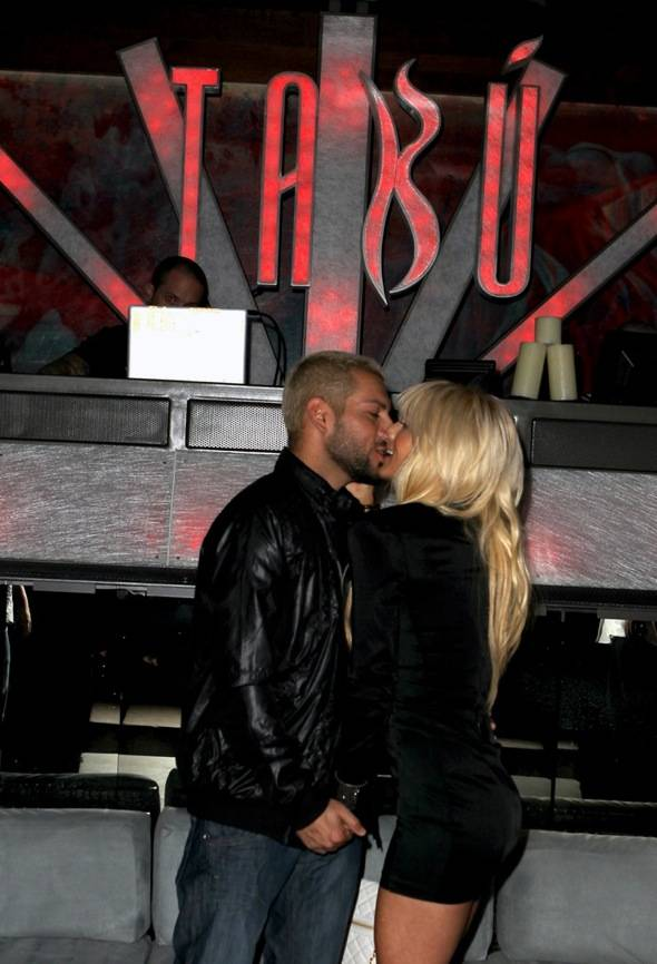 Nik Richie and Shayne Lamas kissing inside Tabú Ultra Lounge