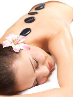 Smiling female face – Hot stone massage in the day spa