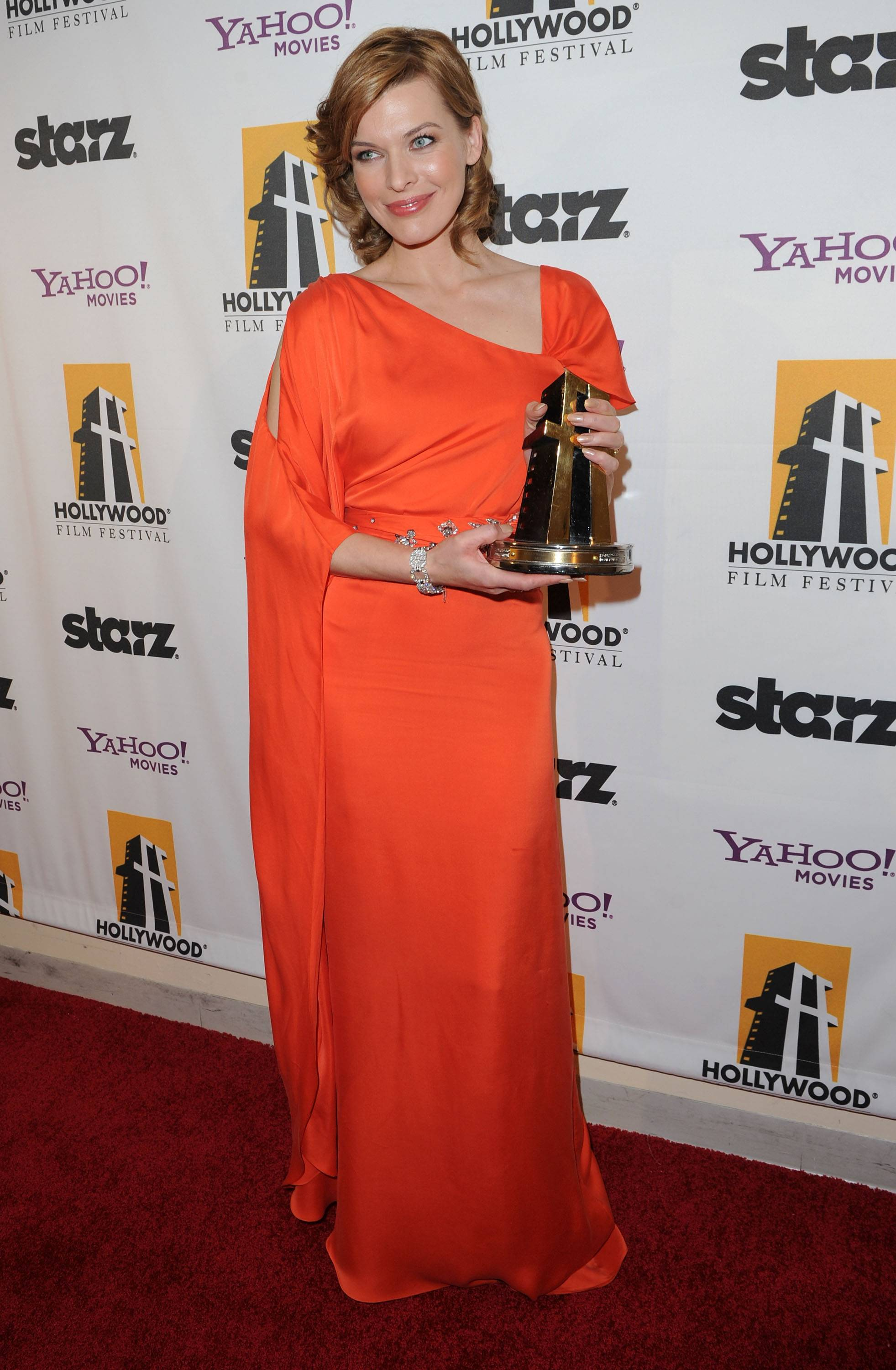 Actress Milla Jovovich poses with the Hollywood Spotlight Award during the 14th annual Hollywood Awards Gala at The Beverly Hilton Hotel on October 25, 2010 in Beverly Hills, California.