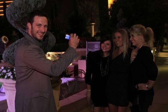 Brady taking photo of Tiffani and pals