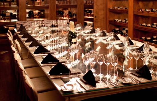 Table setting for Krug luncheon at The Forge
