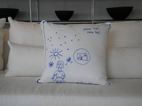 """Pillow Fight"" throw pillow designed by celebrity comedian Sarah Silverman displayed in the Baltus Collection showroom."