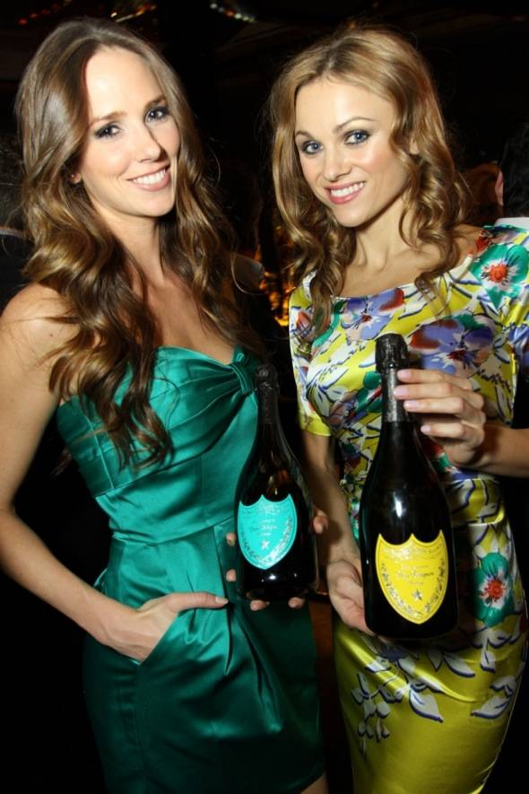 Mandarin Oriental Las Vegas guests with bottles of A Tribute to Andy Warhol 2000 vintage by Dom Pérignon