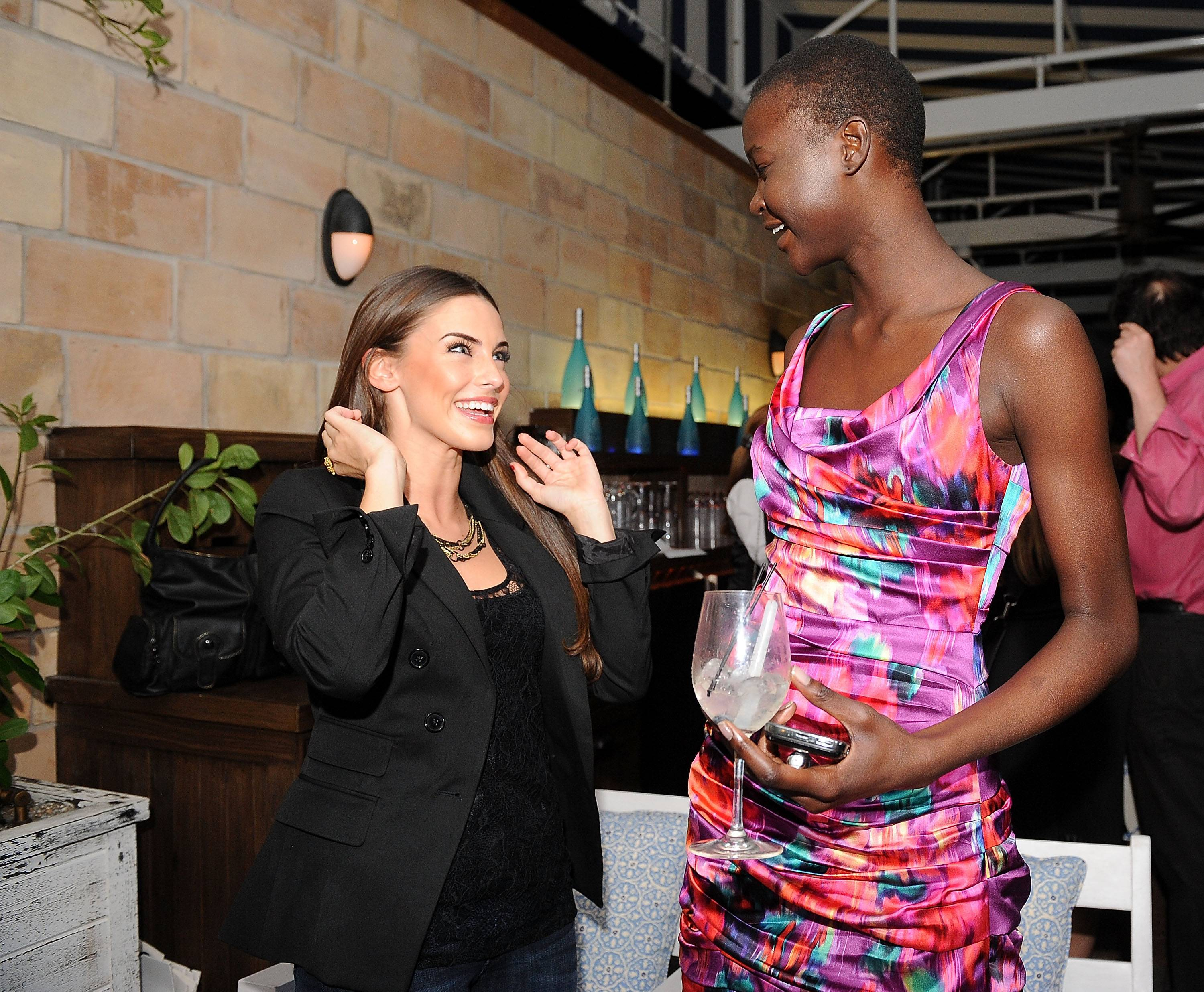 Actress Jessica Lowndes and Ataui Deng (R) attend the Express Spring 2011 Runway Show and After Party at the Soho Beach House on November 20, 2010 in Miami Beach, Florida.