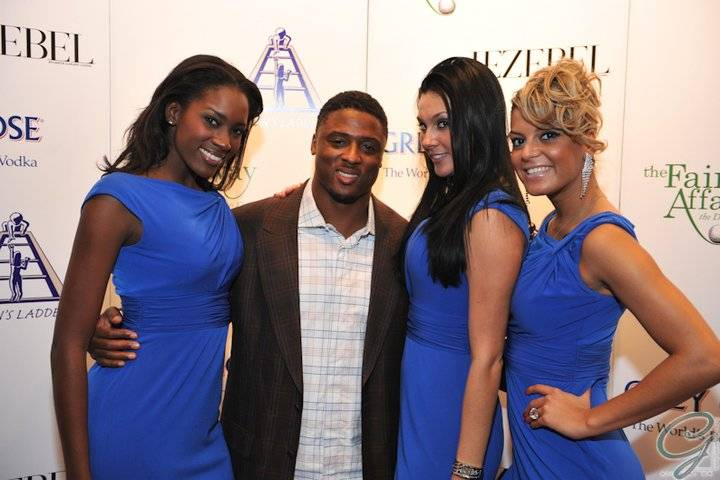 Warrick Dunn with Grey Goose Models at the gala