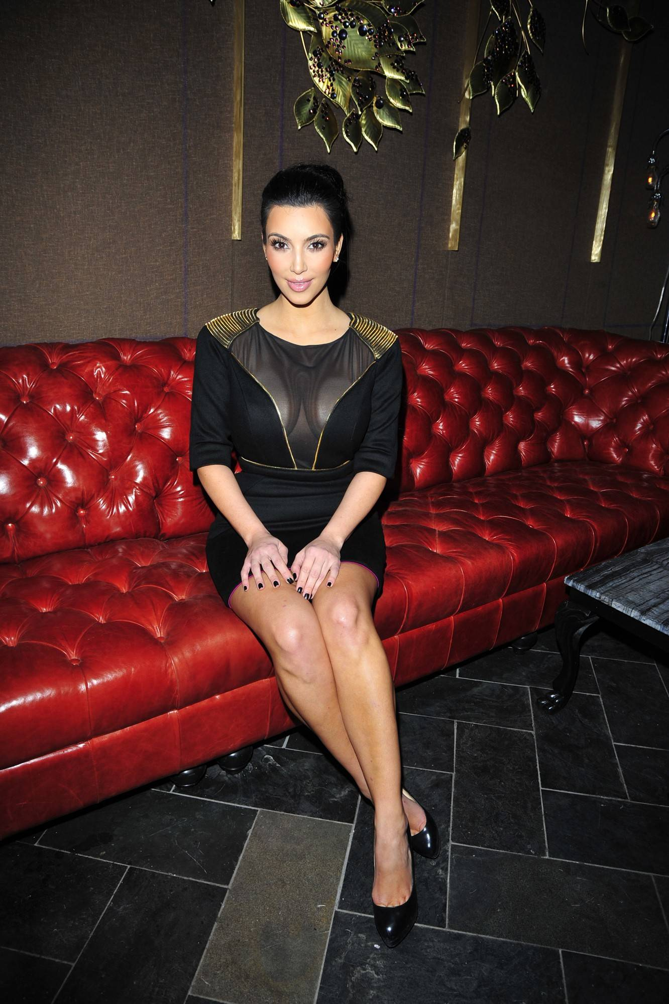 Kim-Kardashian-sits-inside-Beauty-Essex-at-grand-opening92