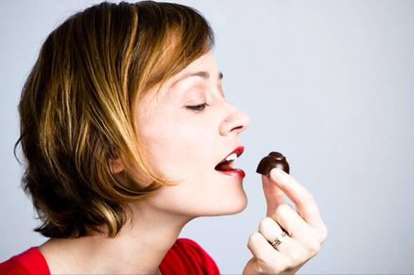 woman-eating-chocolate