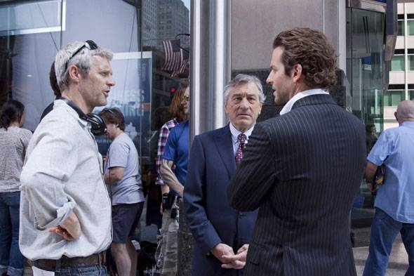 Director Neil Burger reviews a scene with star Robert De Niro and Bradley Cooper on the set of LIMITLESS