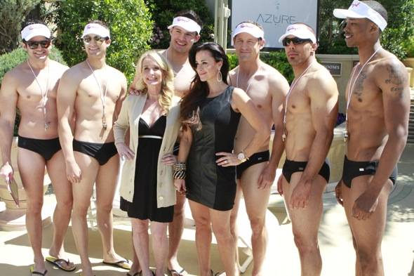 Kim and Kyle Richards pose with Spiegel cabana boys at Azure Luxury Pool