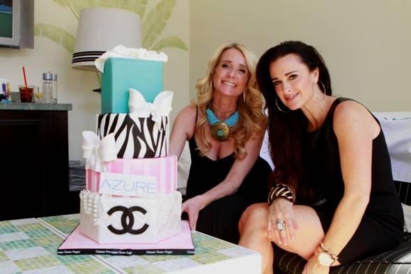 Kim and Kyle Richards with cake at Azure Luxury Pool