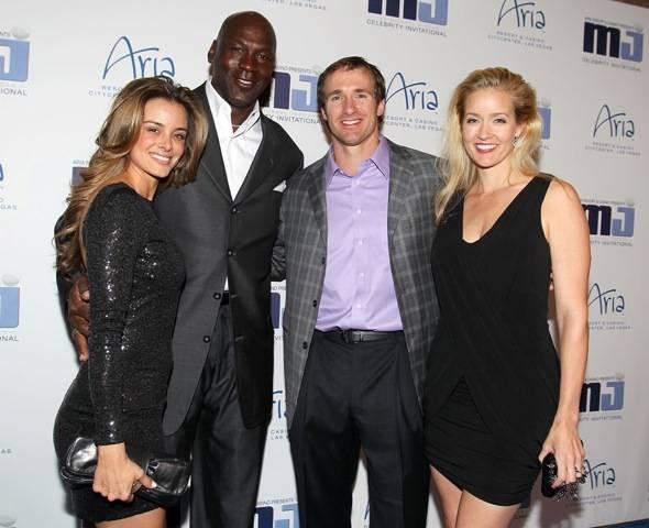 Yvette Prieto, Michael Jordan, Drew Brees and Brittany Brees on blue carpet at MJCI Celebration, Las Vegas