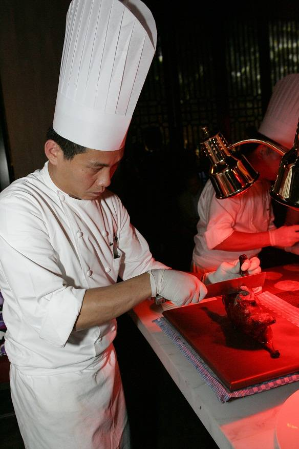 Chef de Cuisine Pang Pin Lee preparing Peping duck with Royal Beluga caviar at last year's Hakkasan Abu Dhabi launch at the Emirates Palace
