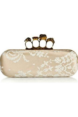 knuckle-duster satin covered Clutch