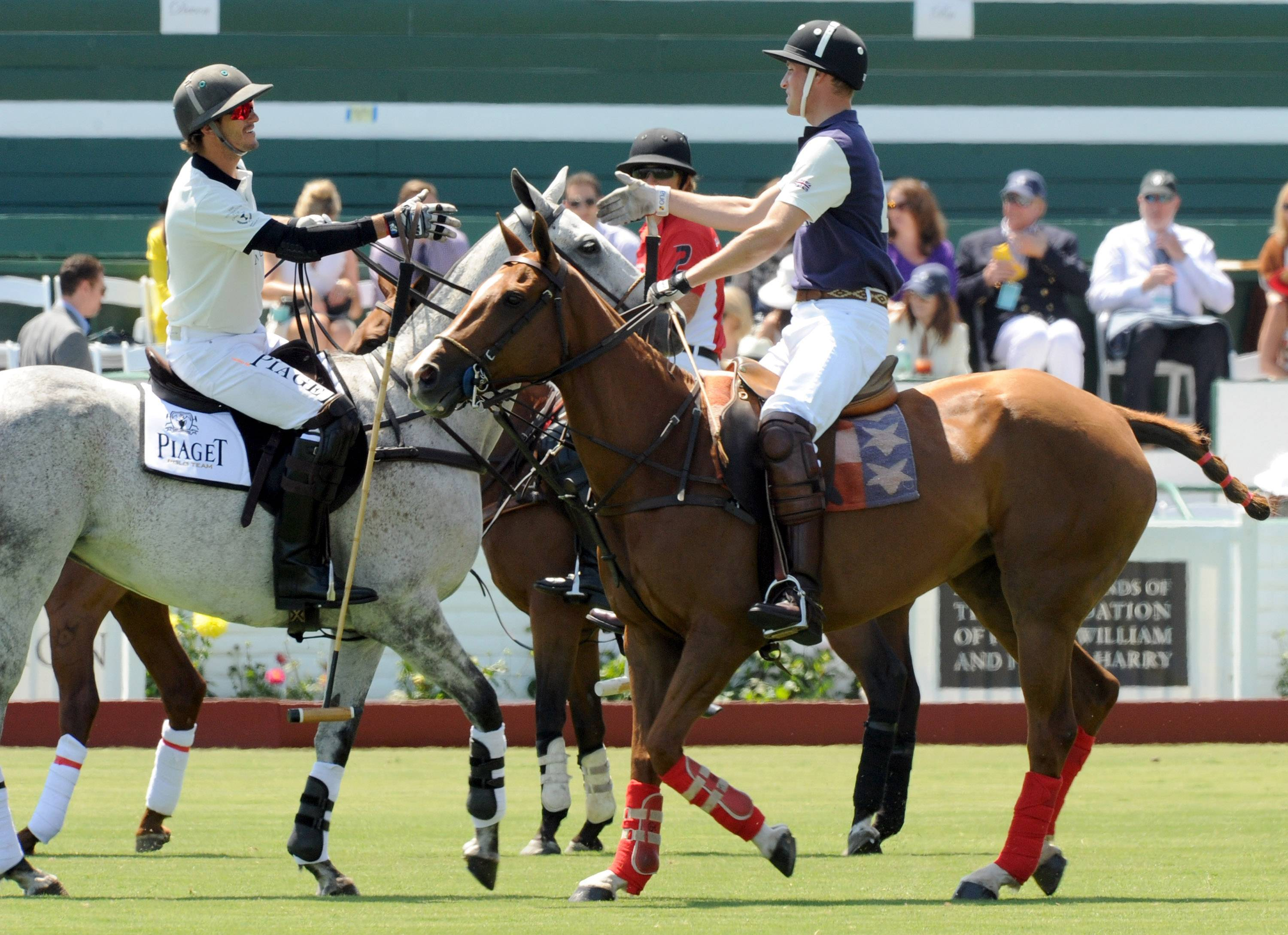 Prince William, Duke of Cambridge (R) competes in the Foundation Polo Challenge held at the Santa Barbara Polo and Racquet Club on July 9, 2011 in Santa Barbara, California.
