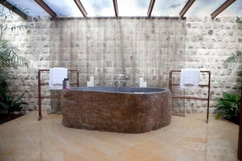 volcanic boulder bathtubs