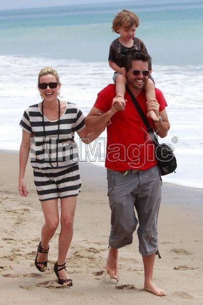 Actress Kathleen Robertson, husband Chris Cowles and their son William