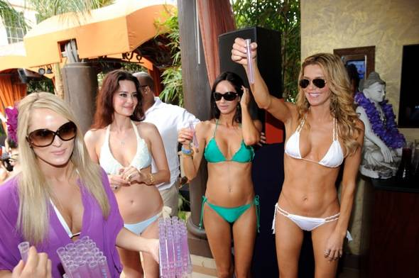 Brandi Glanville and friends toast with Hpnotiq Harmonie shots at TAO Beach