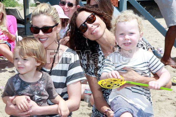 Kathleen Robertson, her son William and Actress Minnie Driver with her son Henry