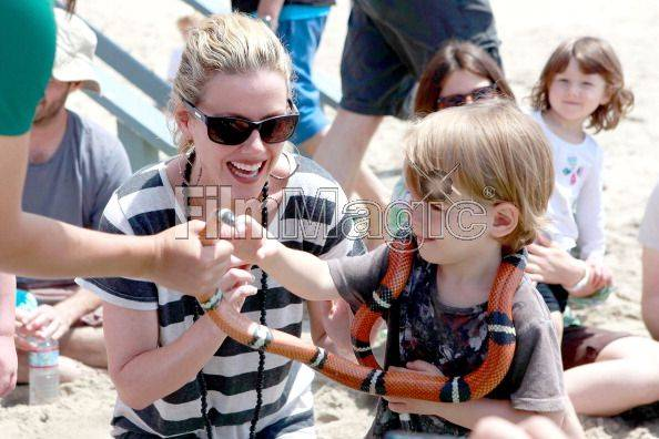ctress Kathleen Robertson and her son William play with animals