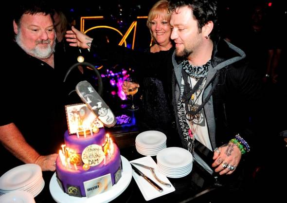 Bam Margera encourages dad Phil to take first bite of birthday cake at Studio 54, 10.01.11