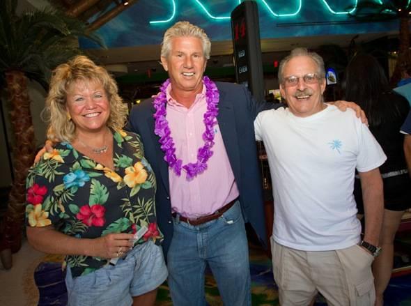 John Cohlan of Margaritaville Holdings with Jimmy Buffett ticket winners Ron and Linda