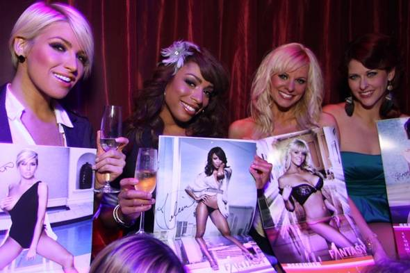 """A few of the girls showing off their month in the 2012 """"Ultimate FANTASY"""" calendar"""