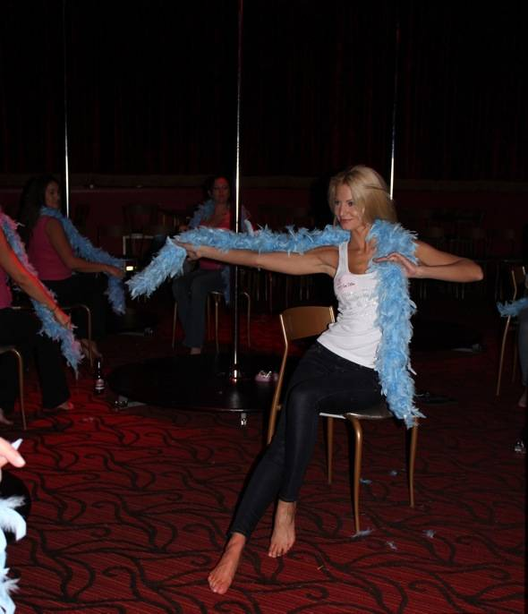 Angela Marcello with blue boa in class