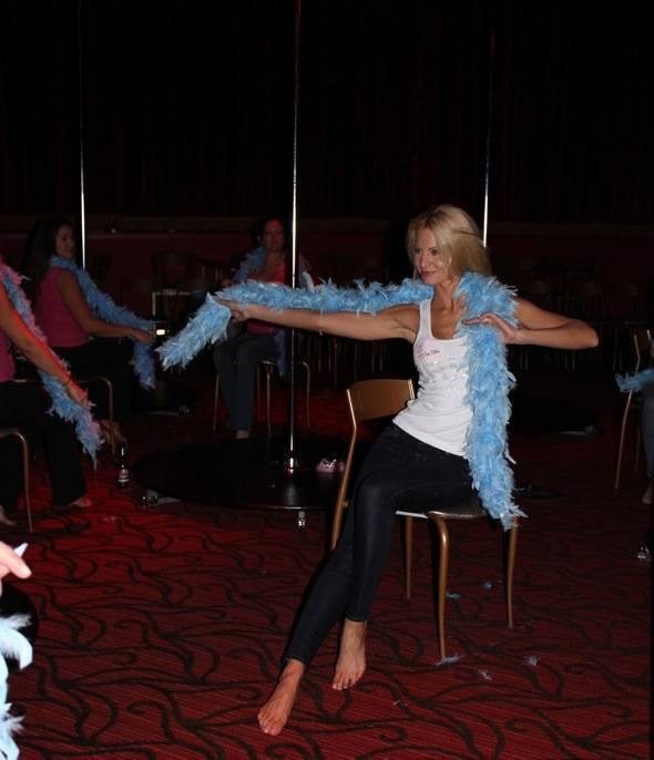 Angela Marcello with blue boa in class