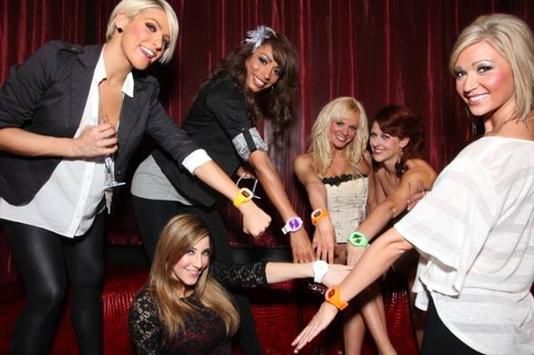The ladies show off their new watches gifted from a fan