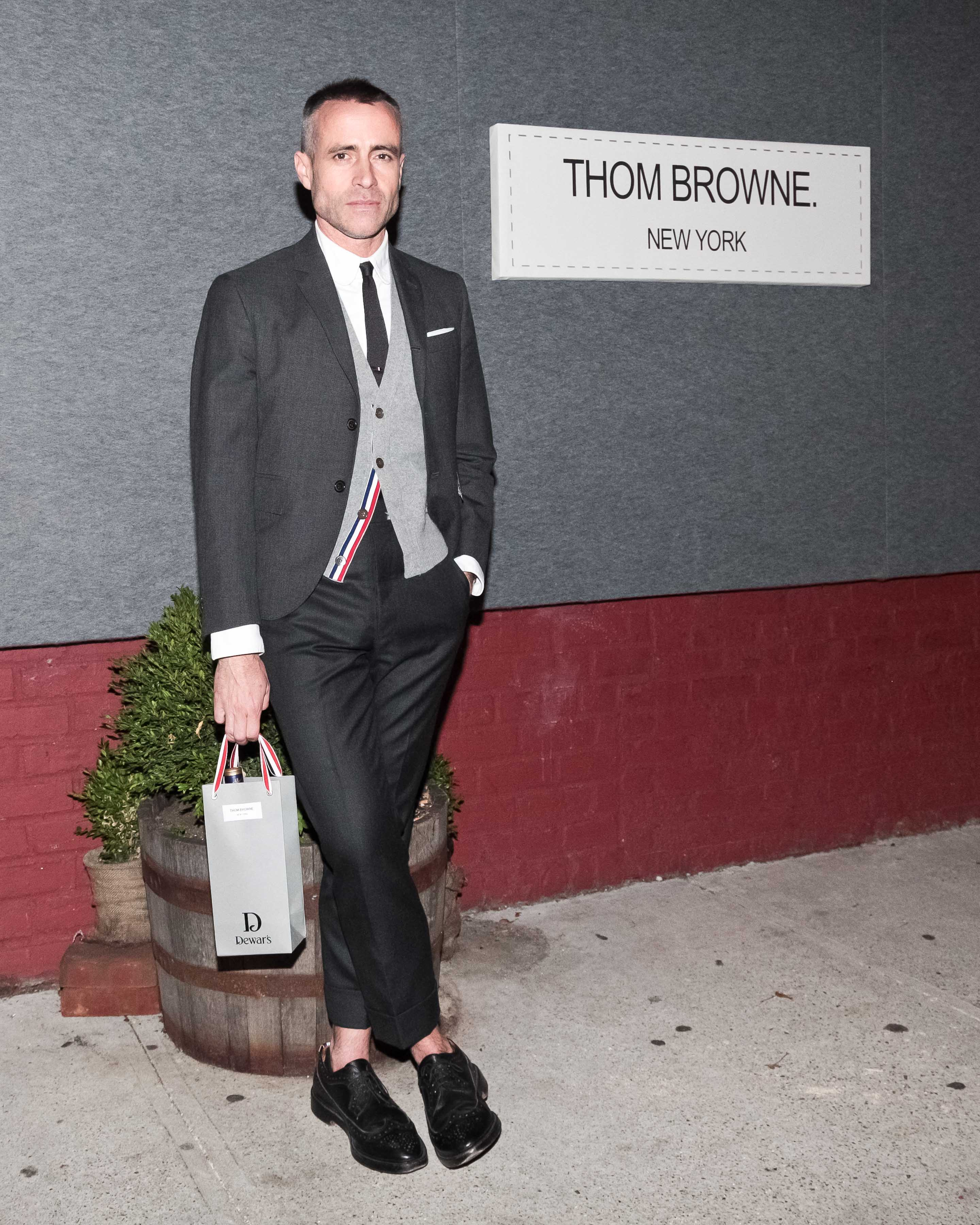 Thom Browne with bag outside