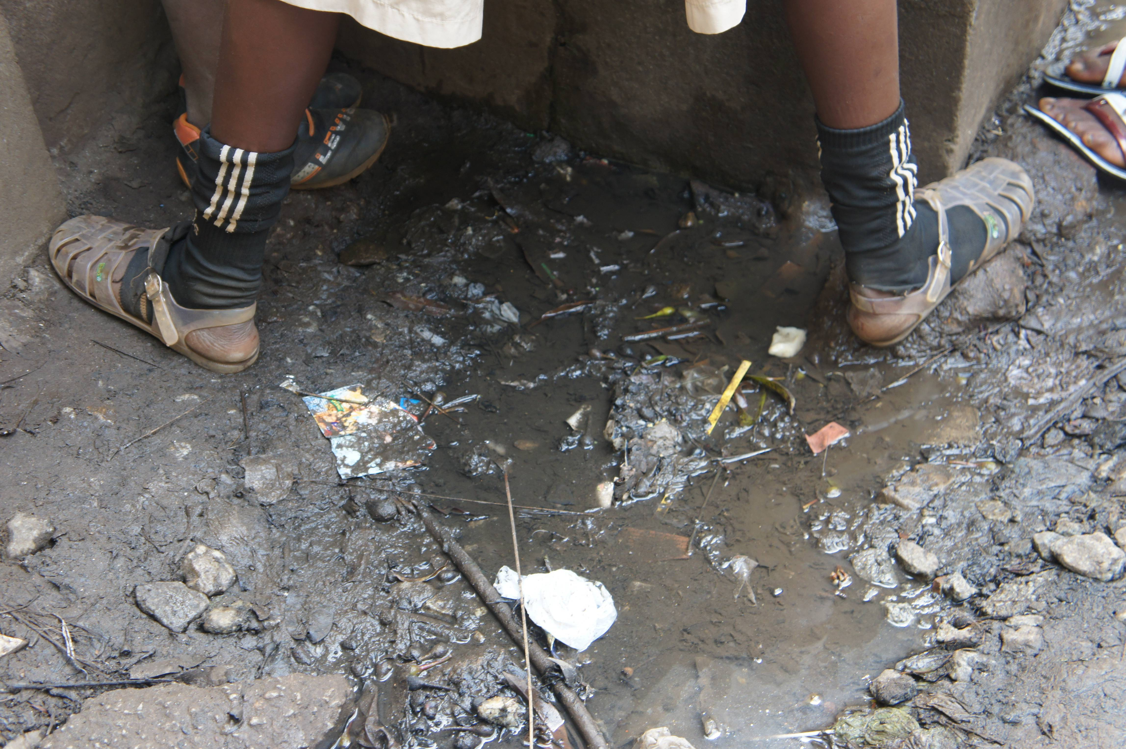 Student Standing in Dirty Water