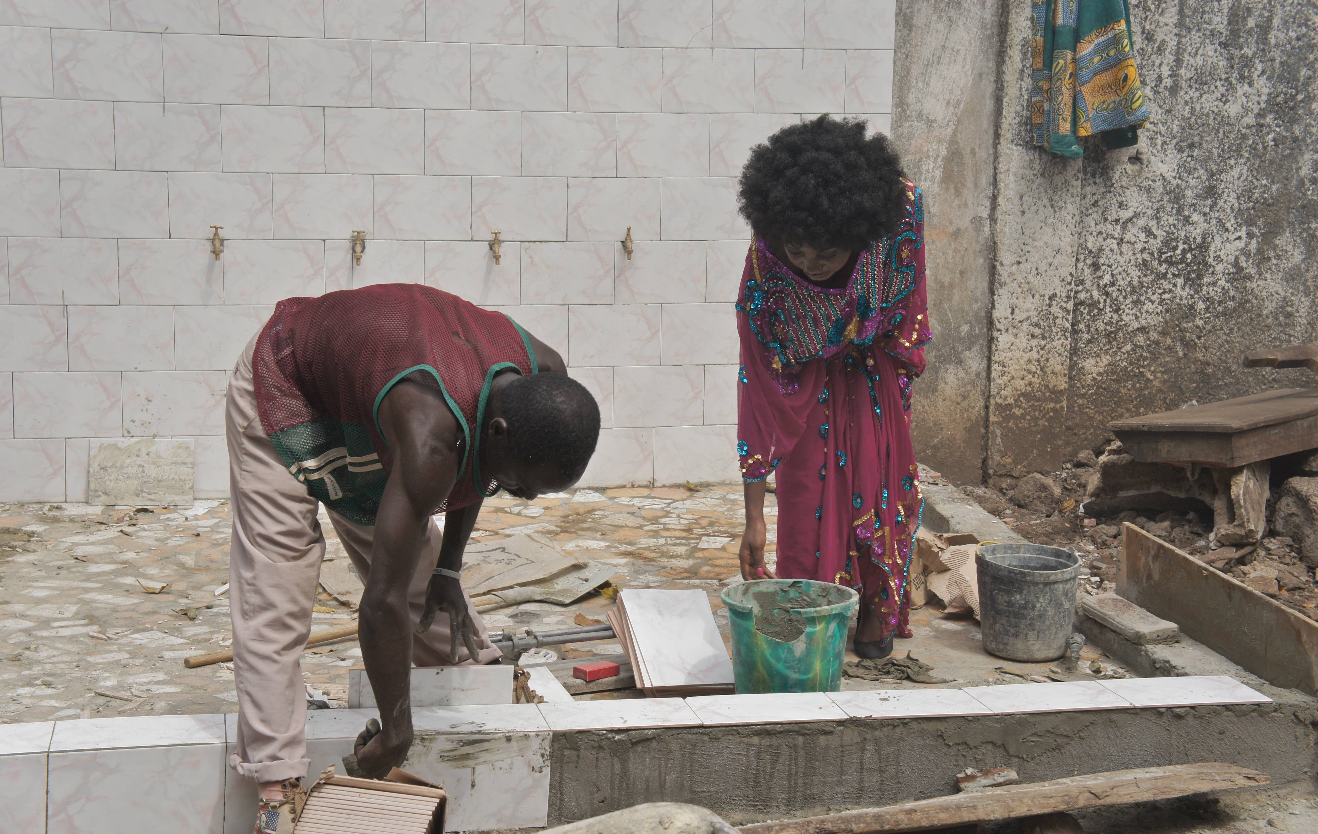 Guinean Construction Worker Working with Me