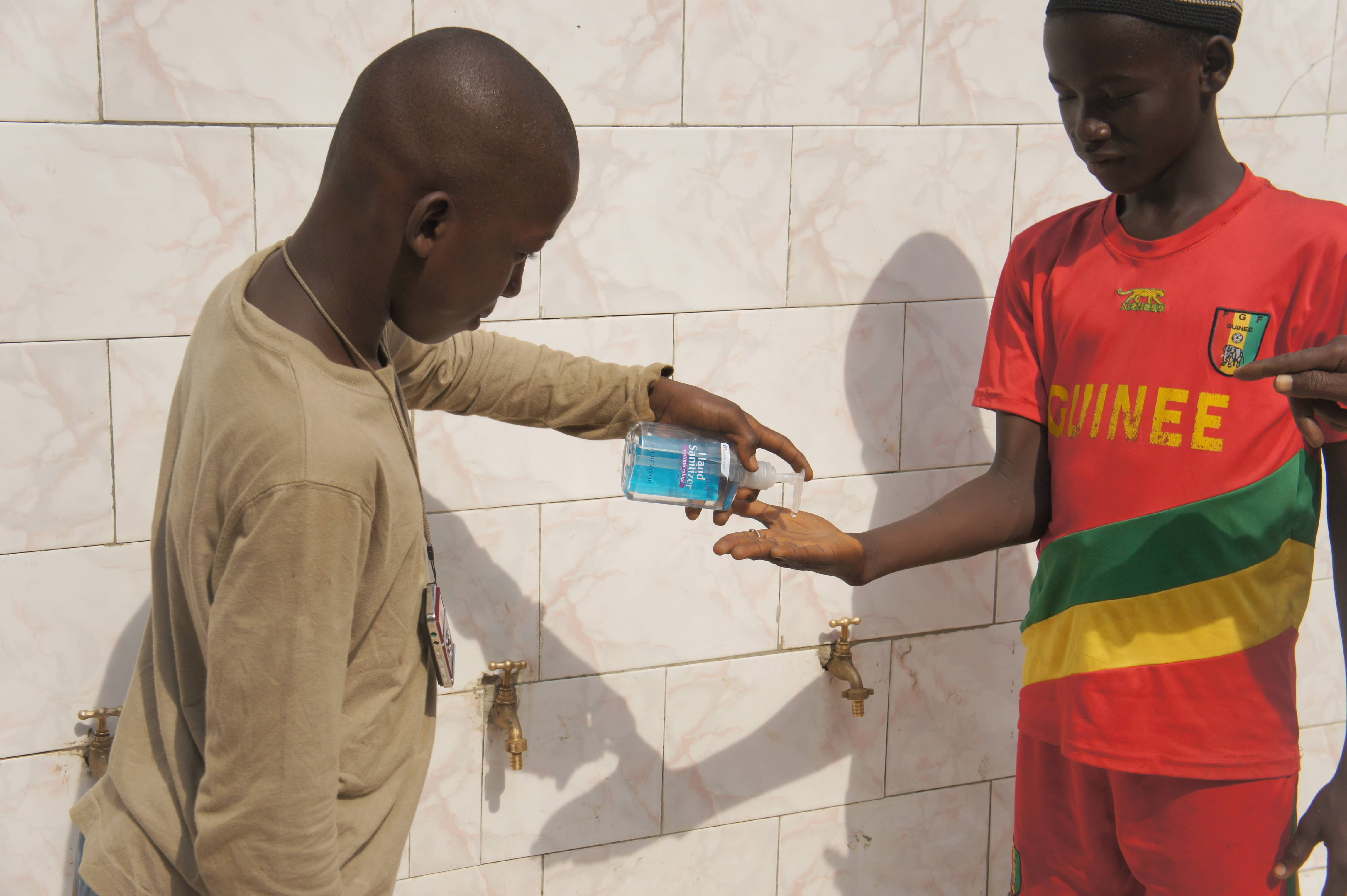 Students Washing their Hands at Tombo II Primary School in Guinea