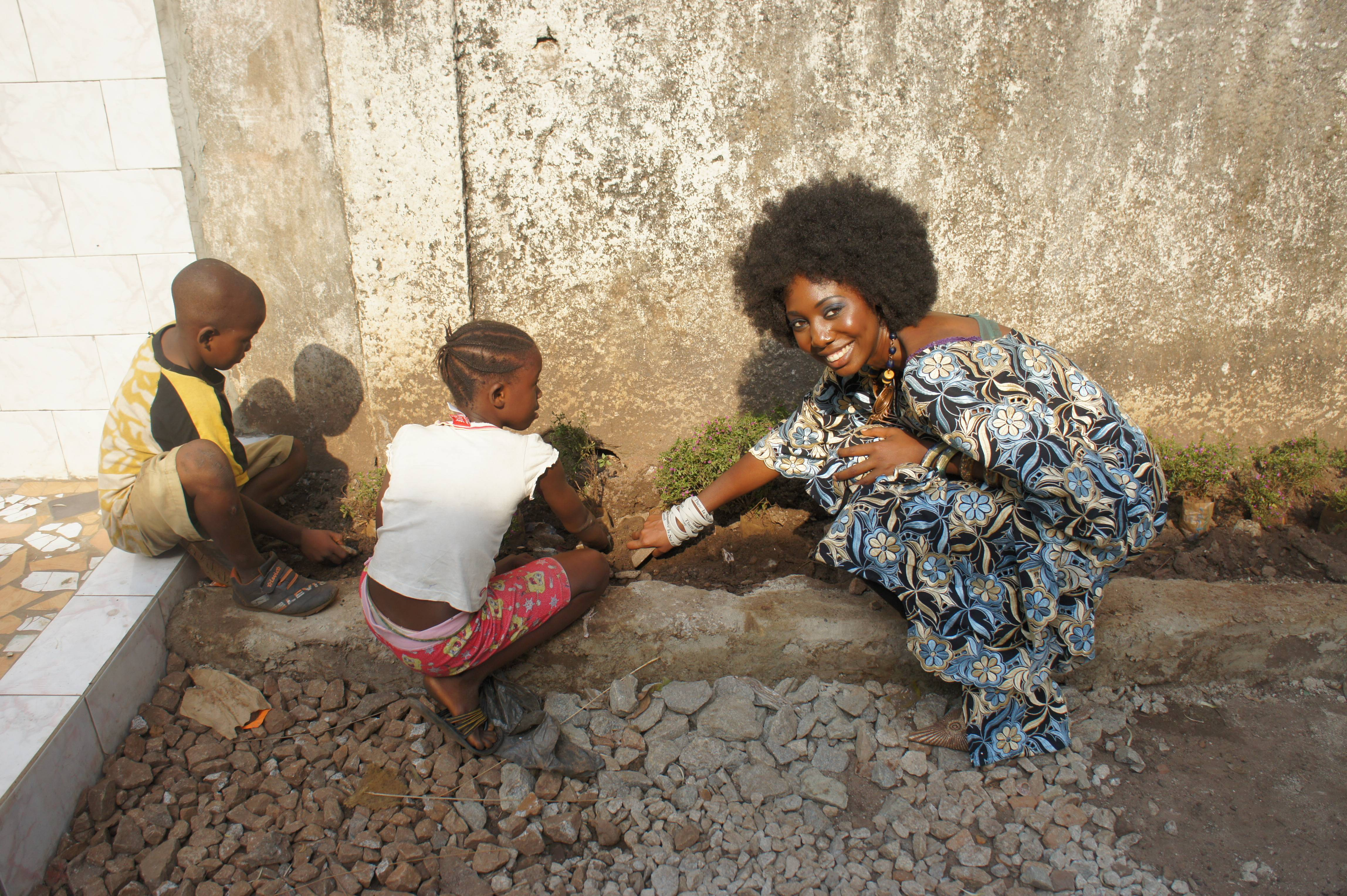Students  and Me (Mariama M. Petrolawicz) Planting Flowers at Tombo II Primary School in Guinea