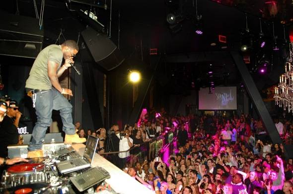 Nelly peforming on top of DJ booth