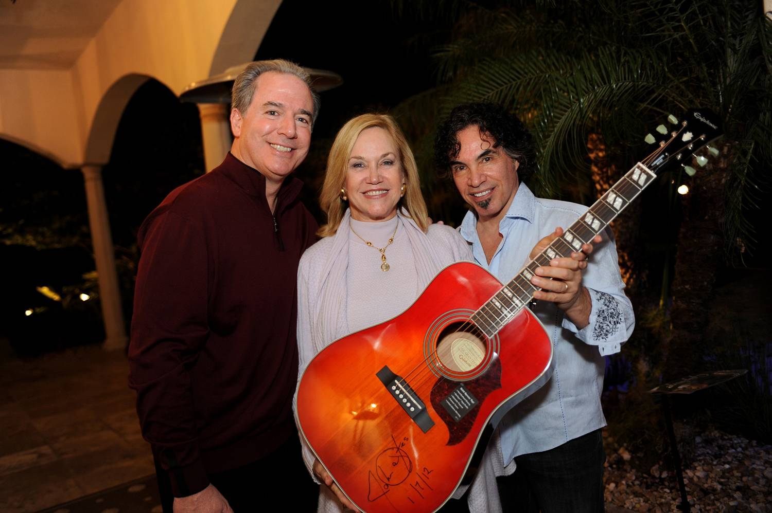 P4- Mike Maroone, Chief Operating Officer of AutoNation, Inc. and his wife Monica Maroone, with John Oates and signed guitar