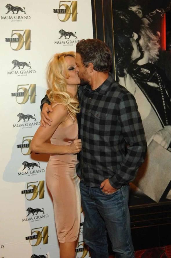 Pamela Anderson and Jon Rose kiss at Studio 54