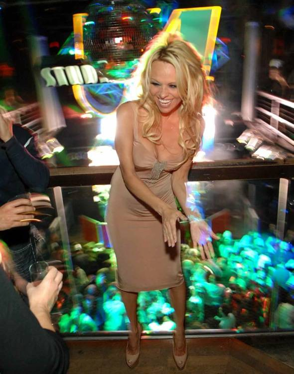 Pamela Anderson dances at Studio 54 for New Year's Eve.