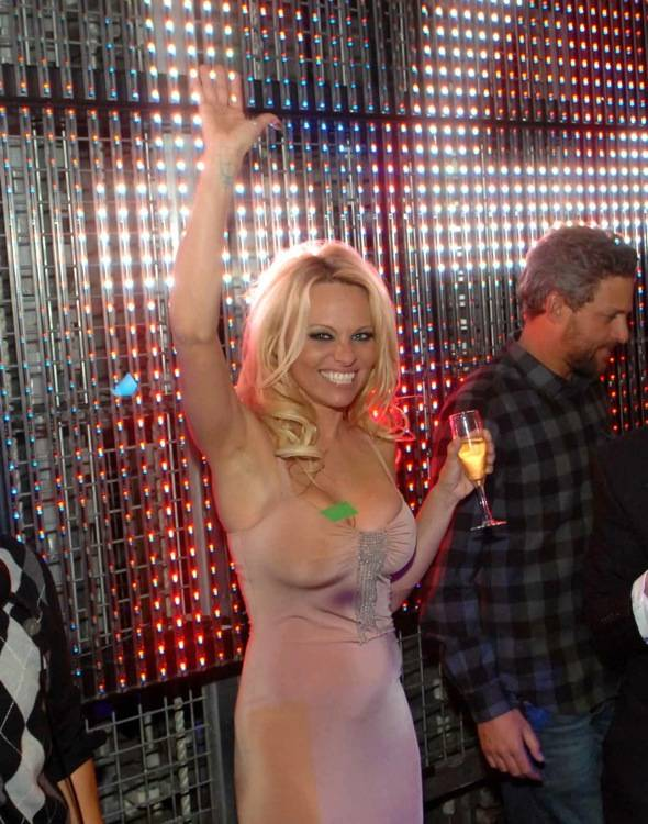Pamela Anderson toasts the New Year at Studio 54