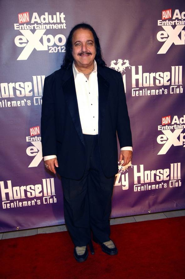 Ron posing on red carpet