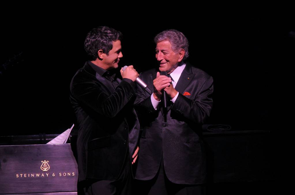 Alejandro Sanz and Tony Bennett perform a duet at a previous Tony Bennett benefit gala. Tony and Alejandro will perform together again on March 19th.