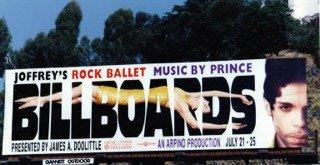 Billboards with Prince atop the Hollywood Hills