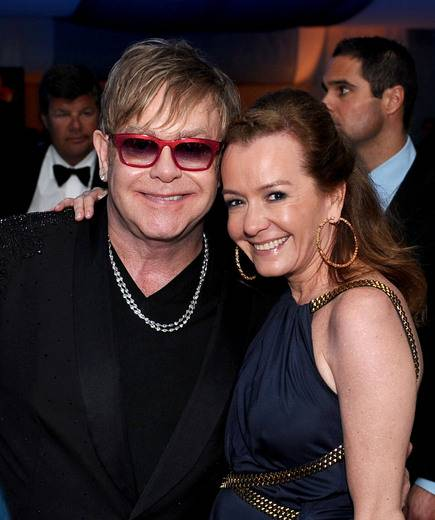 Sir Elton John and Caroline Scheufele, Chopard Co-President & Creative Director at the EJAF Academy Awards Viewing Party