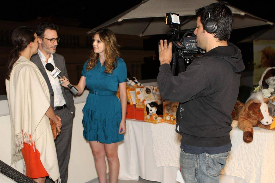 Carly Steel interviewing The Artist's Berenice Bejo and Michel Hazanavicius for Dick Clark Productions' Pre Golden Globes coverage at the DPA Gifting Suite