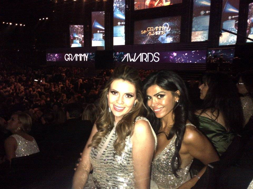 Carly Steel with Sheila Shah at the 54th Grammy Awards in Pamella Roland and Avakian